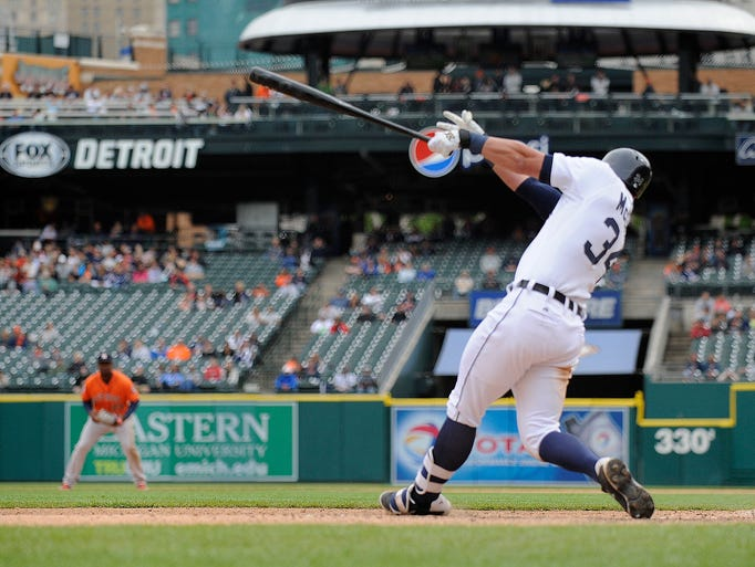 The Tigers'  James McCann follows through after hitting