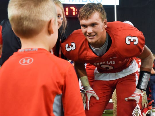 Gregory running back Jayd VanDerWerff (3) talks with a young fan after defeating Irene-Wakonda in the Class 9AA football state championship game on Nov. 9, 2017 in Vermillion, S.D.. Gregory beat Irene-Wakonda 56-30.