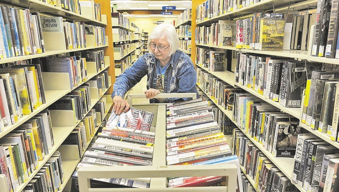 Judy Bostic does volunteer work at the Sparks Library in 2011.