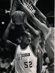 Terry Mills rebounds against Youngstown State. Mills was a junior center on the 1988-89 title team, averaging 11.6 points and 5.9 rebounds that season.