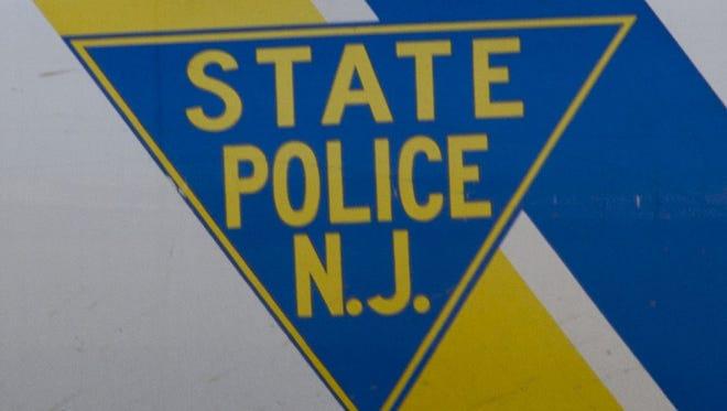 New Jersey State Police emblem.