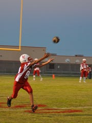 A freshmen receiver takes a throw from quarterbacks during warm ups prior to the Loving vs. Texico game.