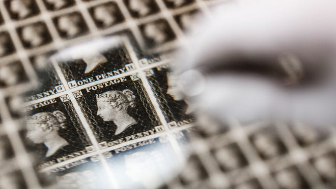 A priceless sheet of Penny Blacks - the world's first ever postage stamp - is inspected before heading abroad for the first time at The Postal Museum on May 25 in London, England.
