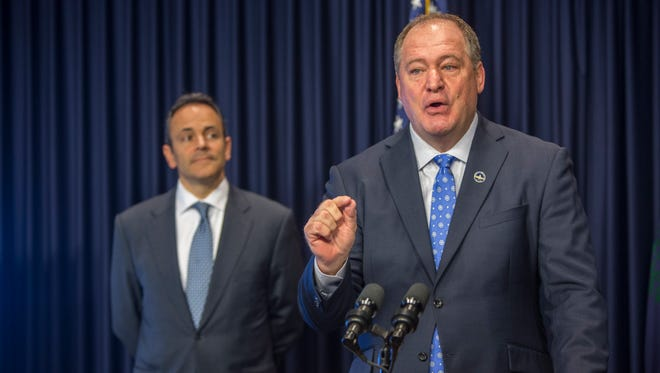 Jeff Hoover, Speaker of the Kentucky State House of Representatives makes a point during the roll out of a state pension reform plan. On left is Governor Matt Bevin. Oct. 18, 2017.