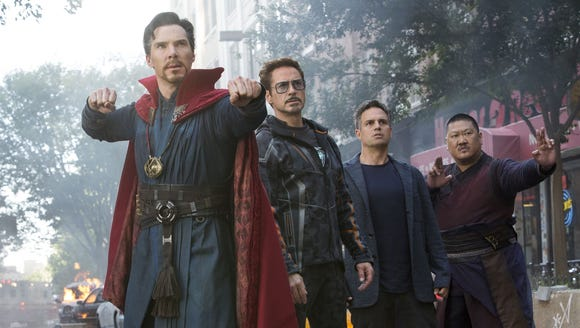 Doctor Strange (Benedict Cumberbatch, left) wields