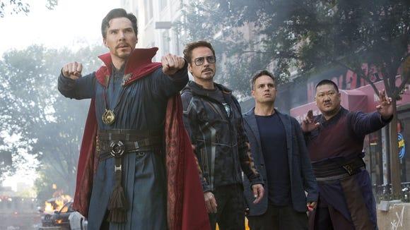 Doctor Strange (Benedict Cumberbatch, left) wields