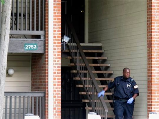 A Memphis police officer walks down a staircase at