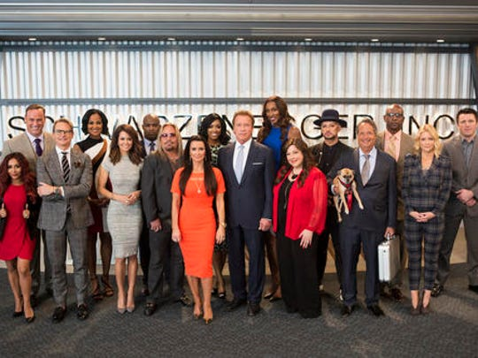 "This image released by NBC shows the cast of ""The New Celebrity Apprentice,"" back row from left, Matt Iseman, Laila Ali, Ricky Williams, Porsha Williams, Lisa Leslie, Boy George, Eric Dickerson, Chael Sonnen, and front row from left, Nicole Polizzi, Carson Kressley, Brooke Burke, Vince Neil, Kyle Richards, Arnold Schwarzenegger, Carnie Wilson, Jon Lovitz and Carrie Keagan in Los Angeles. The new season debuts Jan. 2."