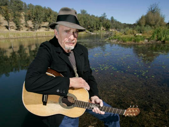 FILE - In this Oct. 2, 2007 file photo, Merle Haggard poses for a photo at his ranch at Palo Cedro, Calif.  The country music star died of pneumonia, Wednesday, April 6, 2016, in Palo Cedro. He was 79.