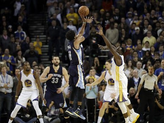 Memphis Grizzlies' Mike Conley (11) makes a basket