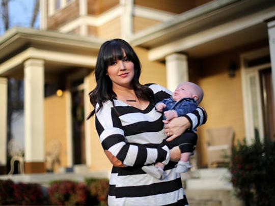 """In this Jan. 31, 2017, photo, Rachel Potter holds her son, Jude, at their home in Nashville, Tenn. Potter, a Nashville-based singer who has toured the country as part of the cast of the hit musical """"Wicked"""" as well as performing gigs with her country music band Steel Union, said she couldn't afford insurance before the Affordable Care Act. From a return to higher premiums based on female gender, to gaps in coverage for breast pumps used by nursing mothers, President Donald Trump's vow to repeal his predecessor's health care law is raising concerns about the impact on women's health."""