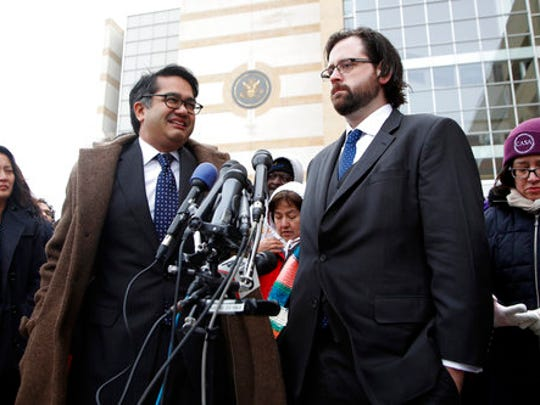 Omar Jadwat of the ACLU, left, and  Justin Cox of the National Immigration Law Center, representing the plaintiffs, meet with reporters outside court in Greenbelt, Md., Wednesday, March 15, 2017. A federal judge in Maryland says he will issue a ruling in a lawsuit challenging President Donald Trump's revised travel ban.
