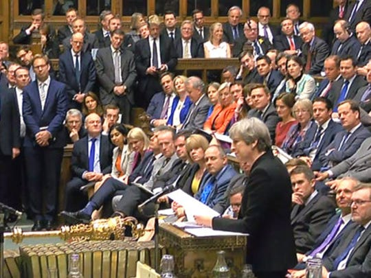 In this image taken from video Britain's Prime Minister Theresa May, standing right, speaks during Prime Minister's Questions in the House of Commons in London. Wednesday April 19, 2017.  On Tuesday May announced plans for a snap general election on June 8.
