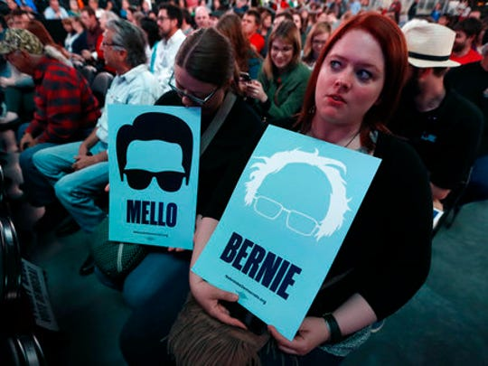 Leah Gregory, of Lincoln, Neb., right, waits for Sen. Bernie Sanders, I-Vt., to arrive at a rally for Omaha Democratic mayoral candidate Heath Mello, Thursday, April 20, 2017, in Omaha, Neb. Sanders, who attracted millions of college-aged and young adults to his presidential campaign last year, is following through on what he said in leaving the 2016 presidential race last year was the Democratic Party's chief responsibility, to welcome younger leaders into its ranks.