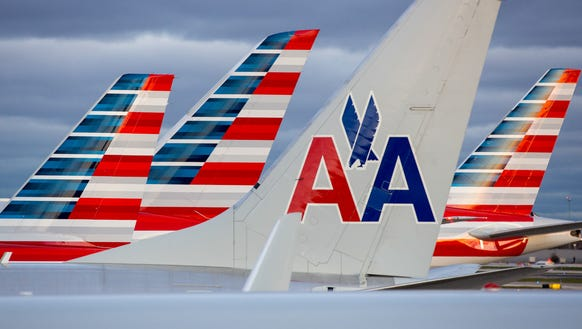 American Airlines tails line up at Terminal 3 at Chicago