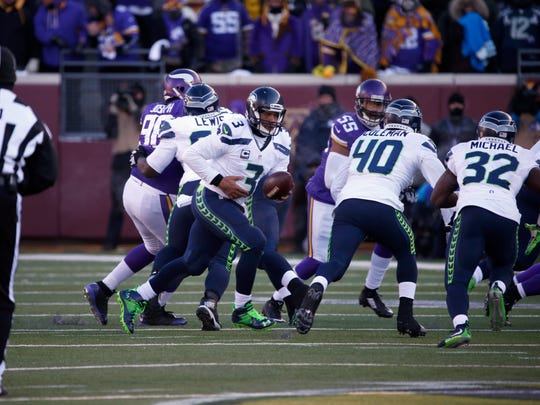 Seattle Seahawks quarterback Russell Wilson (3) prepares to hand off during the second half of an NFL wild-card football game against the Minnesota Vikings, Sunday, Jan. 10, 2016, in Minneapolis.