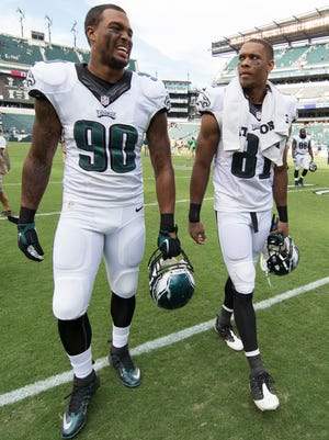 Philadelphia Eagles linebacker Marcus Smith, left, and wide receiver Jordan Matthews, right, walks off the field following the second half of an NFL football game against the Jacksonville Jaguars, Sunday, Sept. 7, 2014, in Philadelphia. The Eagles won 34-17.