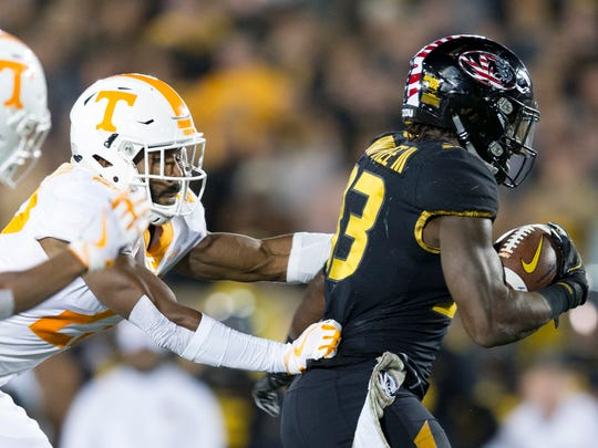 Tennessee defensive back Micah Abernathy (22) chases Missouri running back Larry Rountree III (33) during a game between Tennessee and Missouri at Faurot Field in Columbia, Missouri, on Saturday November 11, 2017.