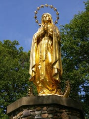 The statue of Our Lady of Lourdes at St. Anne's Shrine. It once stood atop the Cathedral in Burlington and was given to the shrine by the Diocese in 1991.