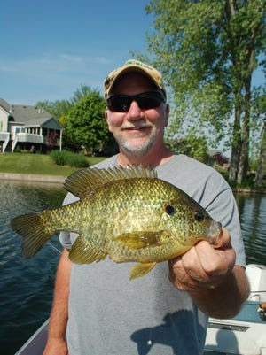 Chris Freiburger shows off a giant redear sunfish.
