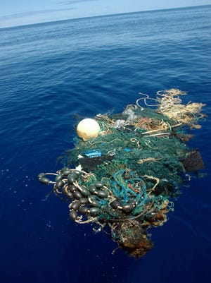 This image provided by the Scripps Institution of Oceanography shows a patch of garbage in the Great Pacific Garbage Patch, about 1,000 miles west of California. The patch is a vortex formed by ocean currents and collects human-produced trash.