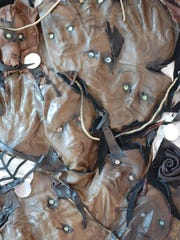 "Dawn McPherson's leather sculpture ""Lost Souls."""