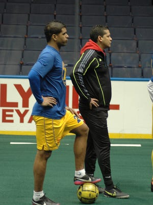Lancers Forward, Yaikel Perez and Assistant Coach Rey Martinez at practice at the Blue Cross Arena in preparation for Thursday night's game.