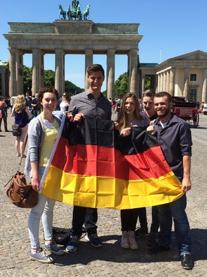 Colin Cole, second from left, poses with his new friends in front of the Brandenburg Gate in Berlin.