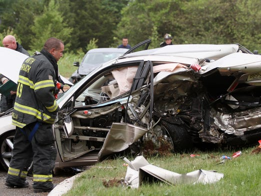 Firefighters work at the scene of a fatal motor vehicle crash, Wednesday, June 11, 2014, that forced the closure of westbound Route 22 near North Gaston Avenue in Bridgewater, NJ.