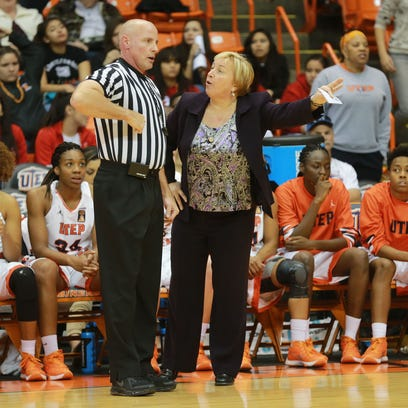 UTEP coach Keitha Adams questions an official about