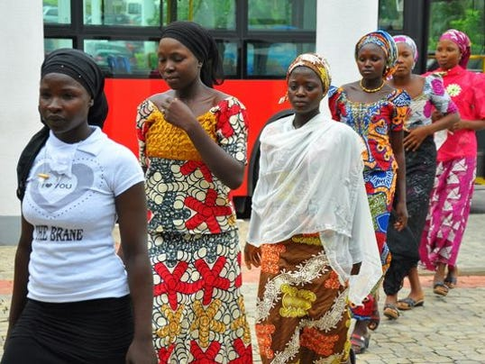 Girls who escaped abduction arrive in Abuja, Nigeria July 22 AP