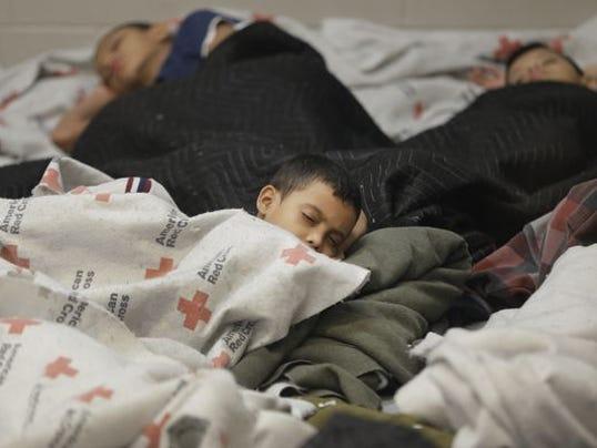 1405970670000-Immigrant-Children-init