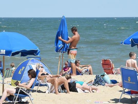 -062414-beach.stand.guy-cs.4523.20140624.nal