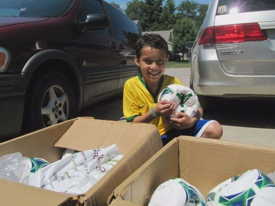 Boy donates soccer supplies