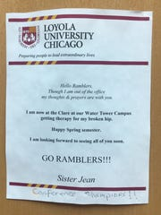 A sign on the outside of Sister Jean's office door at Loyola-Chicago informs people of her broken hip.