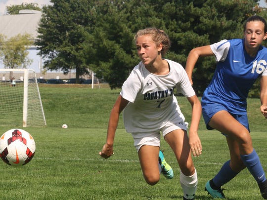 CCD's Joely Virzi (7) and Madeira's Caroline Weiner (16) battle for possession in a match on Sept. 16, 2017.