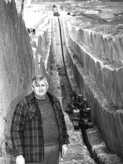 Ron Thompson stands in the trench being cut for the construction of the Quail Creek Dam in February of 1990.
