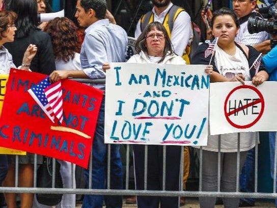 Members of the Mexican community protest outside a