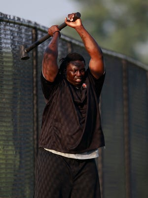 Cincinnati Bengals defensive tackle Pat Sims (90) works out on the side of the field during training camp at Georgetown College in Georgetown, Ky.
