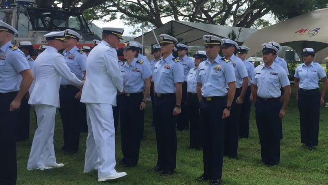 Capt. James Pruett, front right, and Capt. Christopher Chase conduct a uniform inspection of Coast Guard Sector Guam crew members during a change-of-command ceremony at Naval Base Guam July 7, 2017.