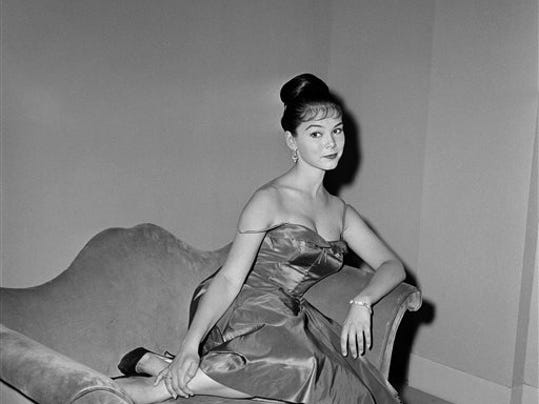 """FILE - In this July 11, 1959, file photo, actress Yvonne Craig poses on the set of """"The Gene Krupa Story,"""" in Los Angeles."""