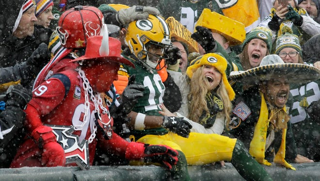 Packers wide receiver Randall Cobb celebrates a touchdown catch during a game against the Houston Texans on Dec. 4 at Lambeau Field in Green Bay.