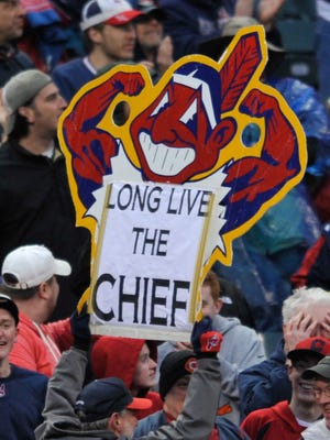 A fan holds a Chief Wahoo sign during a game between Cleveland and Minnesota two seasons ago.
