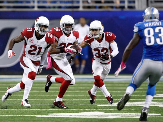 Cardinals safety Rashad Johnson carries the ball after an interception during the fourth quarter against the Detroit Lions.