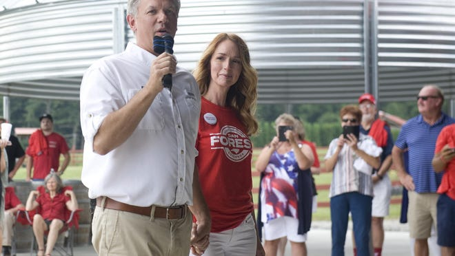 Joined by his wife, Alice Forest, right, N.C. Lt. Gov. Dan Forest, left, the Republican nominee for governor in the 2020 election, speaks to a crowd Saturday at Grandad's Apples N' Such in Hendersonville.