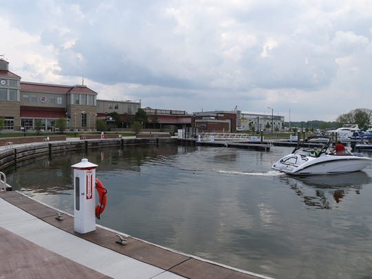 A boat turns around to back into a spot at The Marina