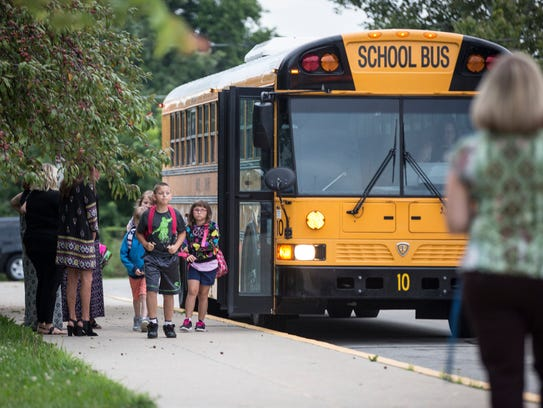 Buses drop kids off at Grissom Elementary Aug. 7 for