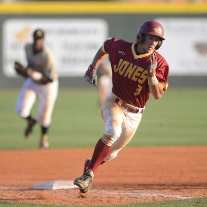 JCJC's Dalton Skelton (3) rounds third and heads home