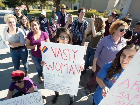 A group of New Mexico State University students and staff gather in front of the NMSU Art Gallery for a political protest on Monday, November 14, 2016.