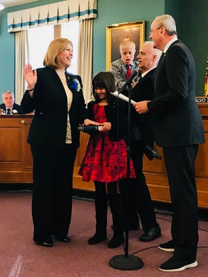 Stephanie McGowan gets sworn into office on Jan. 1 by Gov.-elect Phil Murphy for her second term on the Rutherford Borough Council. Alongside McGowan are her 11-year-old twins, Amelia and Jeffrey Jr., and her husband, Jeff McGowan.